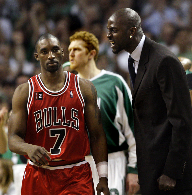 Boston Celtics' Kevin Garnett, right, has words for Chicago Bulls' Ben Gordon during a timeout in a first-round NBA basketball playoff game in Boston Tuesday, April 28, 2009. The Celtics won 106-104 in overtime, and leads the series 3-2. (AP Photo/Elise Amendola)